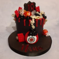 Black buttercream Drip Cake with Red Drip